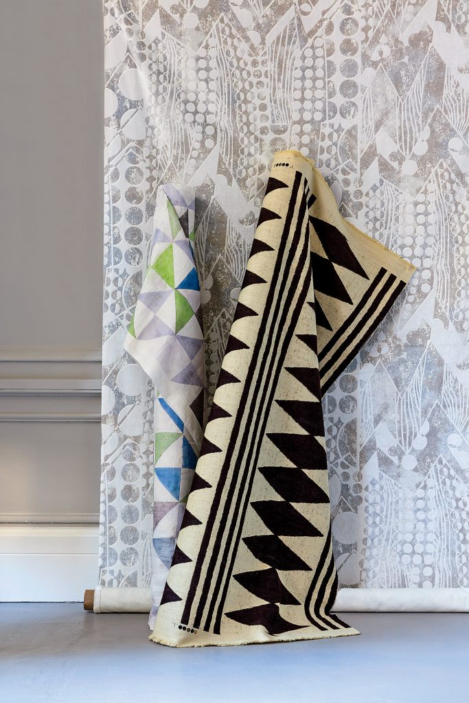"""The cool silver in Pierre Frey's Paquebot is the foil for the earthy palette in Bambara Cloth from Ralph Lauren Home, left, and designer Jennifer Shorto's playful """"Night Flying Bird."""""""