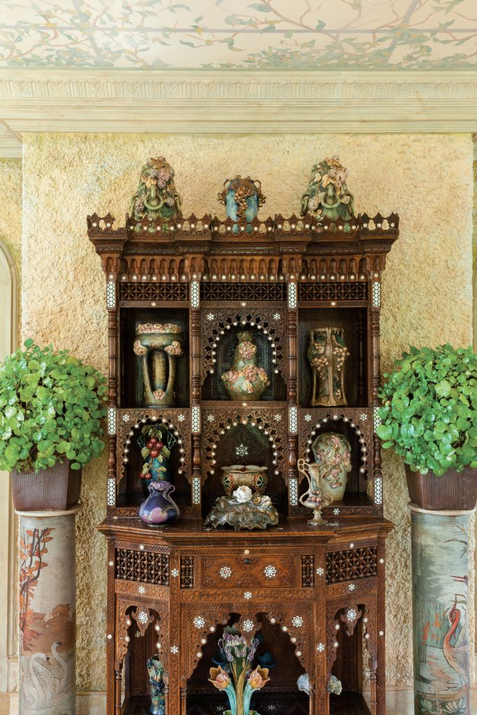 In the solarium, an enviable number of majolica pieces is displayed in a 1880s Egyptian cabinet  decorated with inlays of mother-of-pearl.