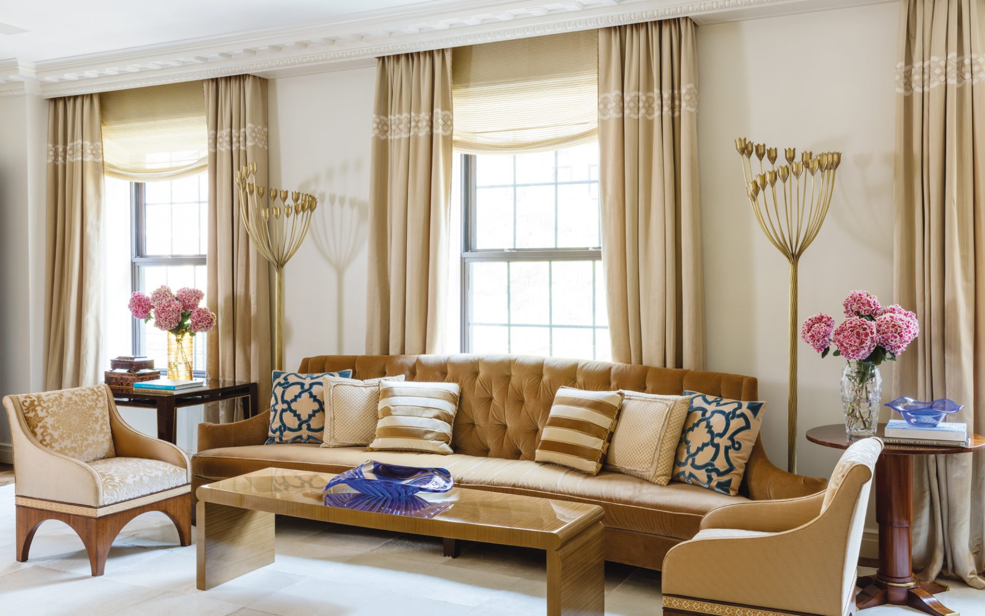 The Gold Hued Living Room Is Furnished With A Number Of Contemporary Pieces Inspired By Vintage Forms These Include Sofa And Armchairs Designed