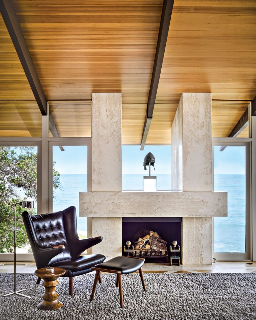 The Living Roomu0027s Monumental Travertine Fireplace Showcases A Greek Bronze  Helmet From The Fifth Century B.C.; A Hans Wegner Chair And Ottoman, ...