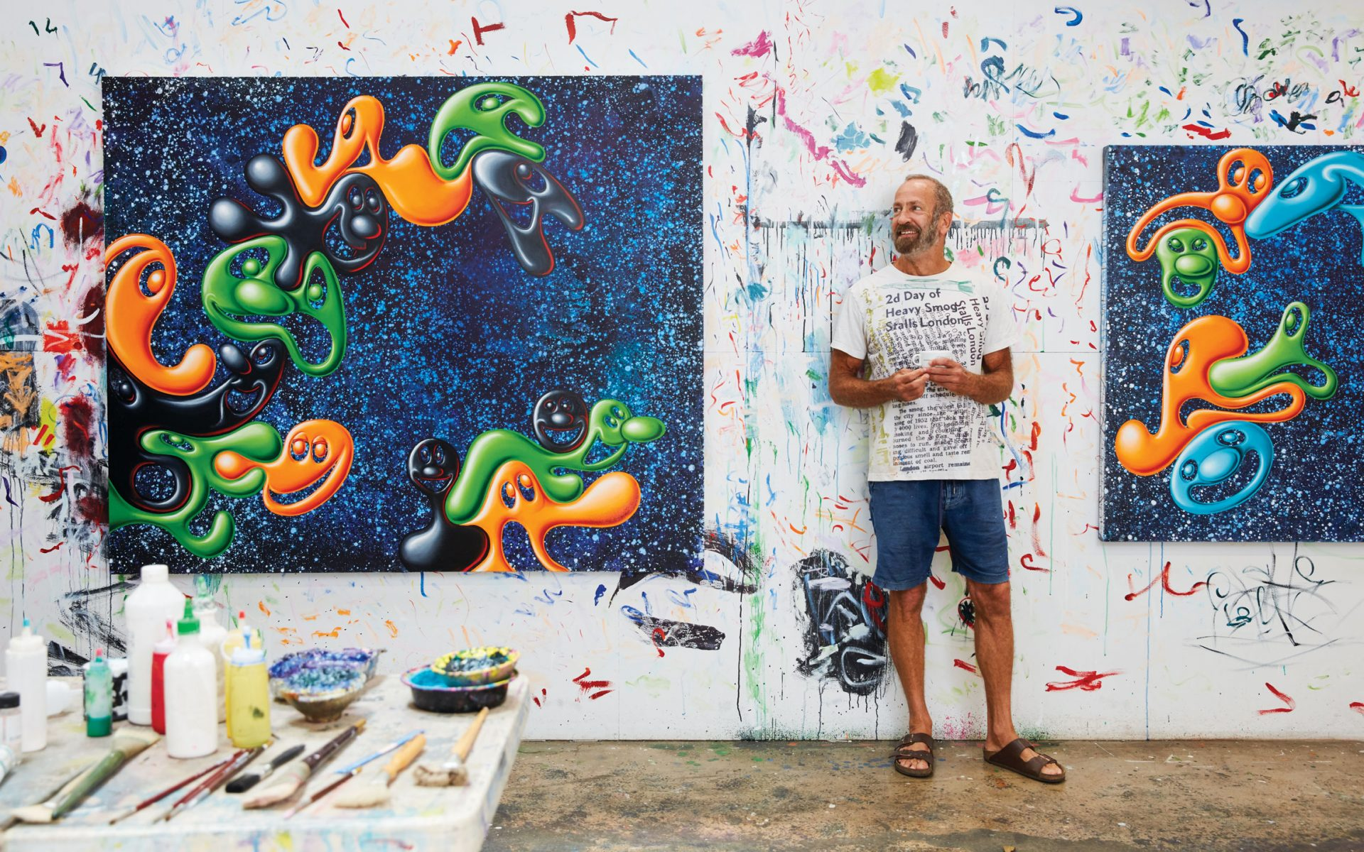 """Artist Kenny Scharf stands with two of his """"Blob"""" paintings in his new  studio in Inglewood cfad254e0"""