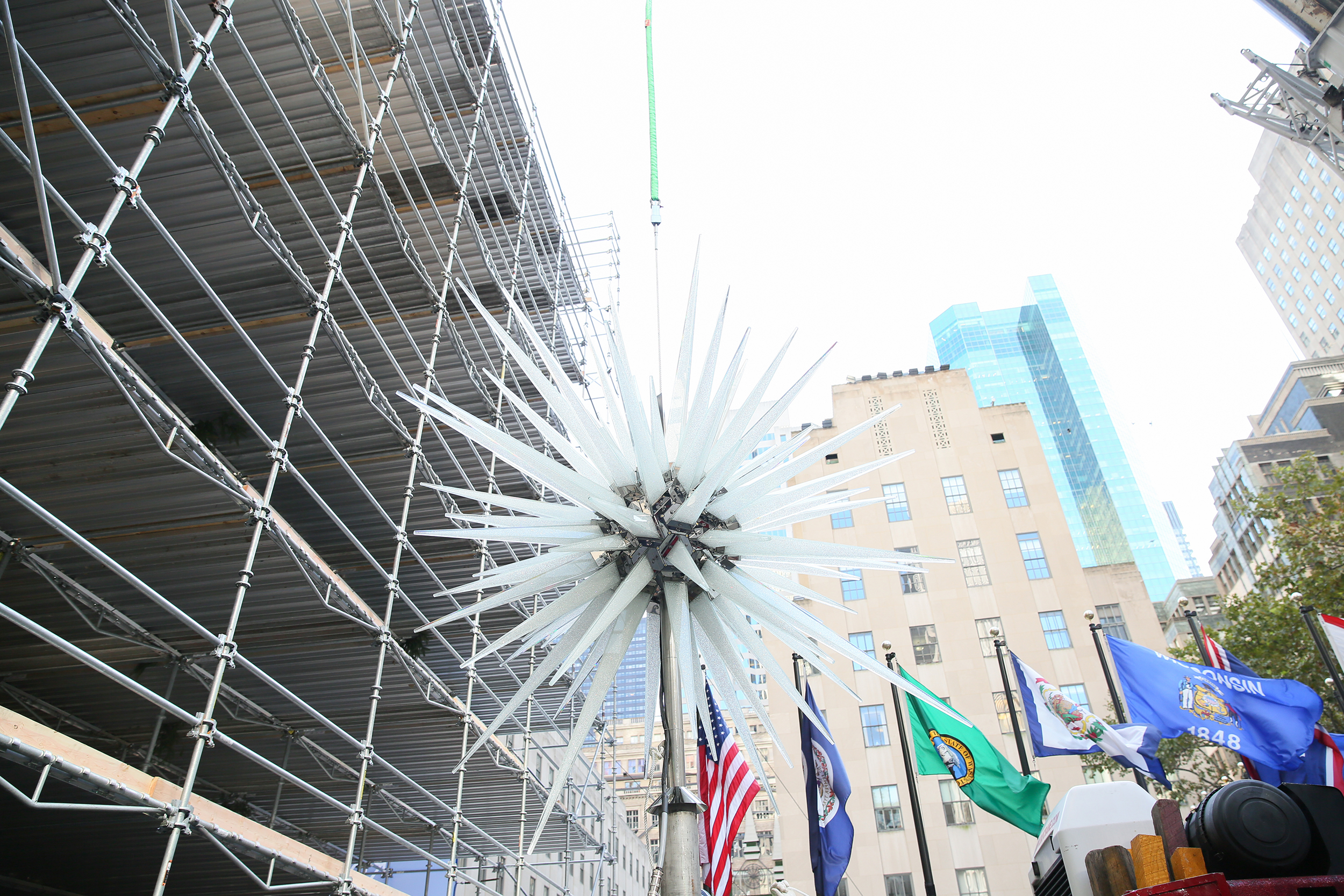 Millions Of Swarovski Crystals Adorn The New Star Atop The