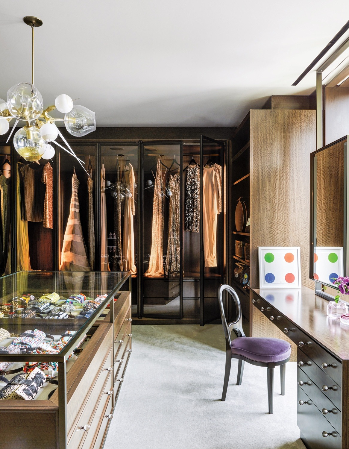 amella Roland's dressing room features a small Damien Hirst spot painting