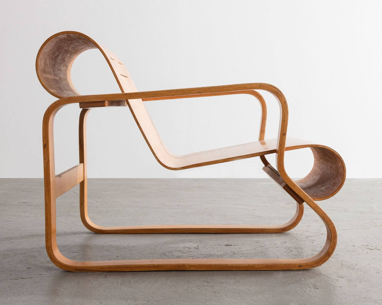 A chair designed by Alvar Aalto.