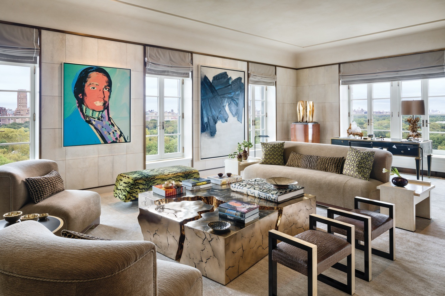 In this living room, designed by Deborah Berke and Christine van Deusen, paintings by Andy Warhol and Pierre Soulages overlook a seating area that includes pieces by Achille Salvagni, Jacques Adnet, and Based Upon. Also in the room are a Barbara Hepworth sculpture, Marc du Plantier desk, and Claude Boeltz lamp.