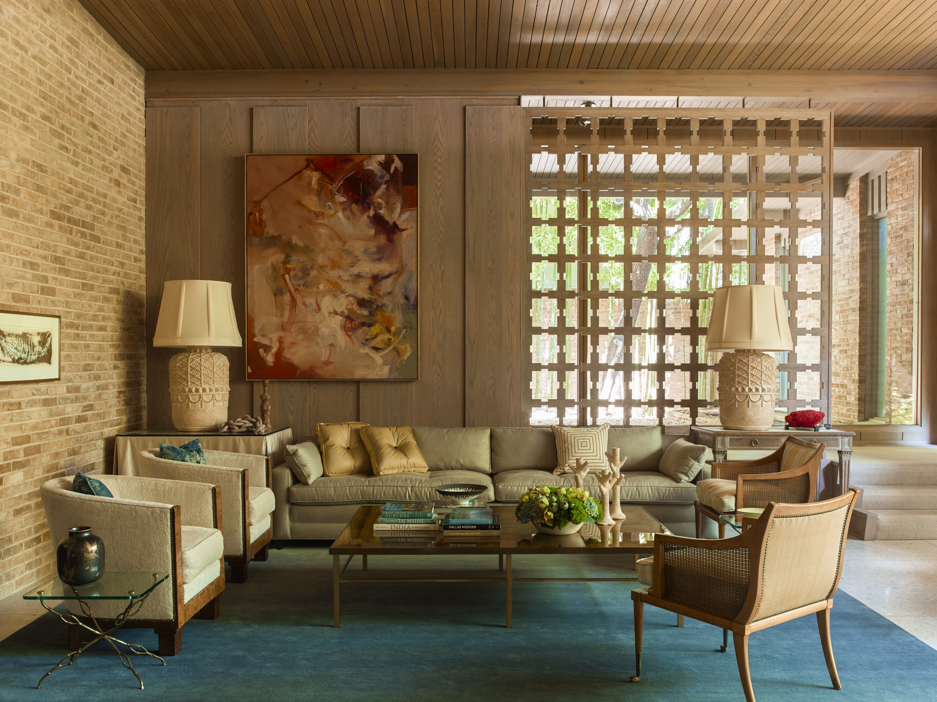 Summers discovered the living room's club chairs in London in the 1960s, and the whitewashed French terra-cotta lamps date from the 1940s.