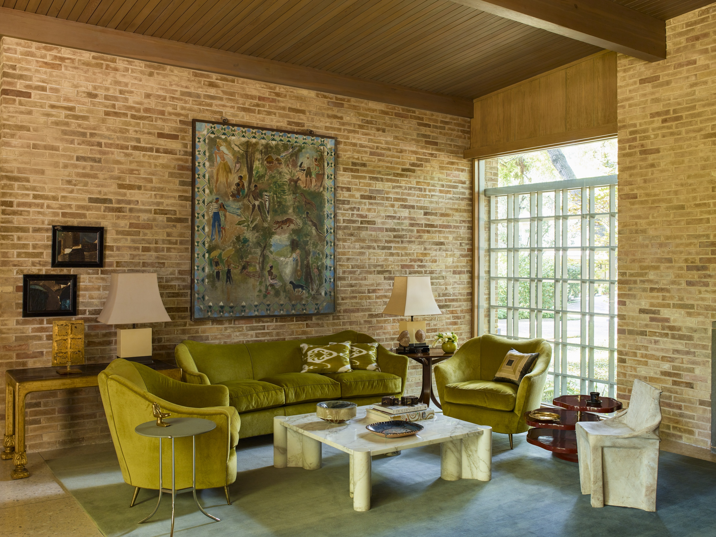 Always a fan of the mix, Summers combines a 1960s Italian sofa and chairs, Gae Aulenti's marble coffee table, French postwar lacquered lamps, and Niels van Eijk's 1997 Cow chair. She found the 1940s painting in Paris, and her husband later surprised her with it as a gift.