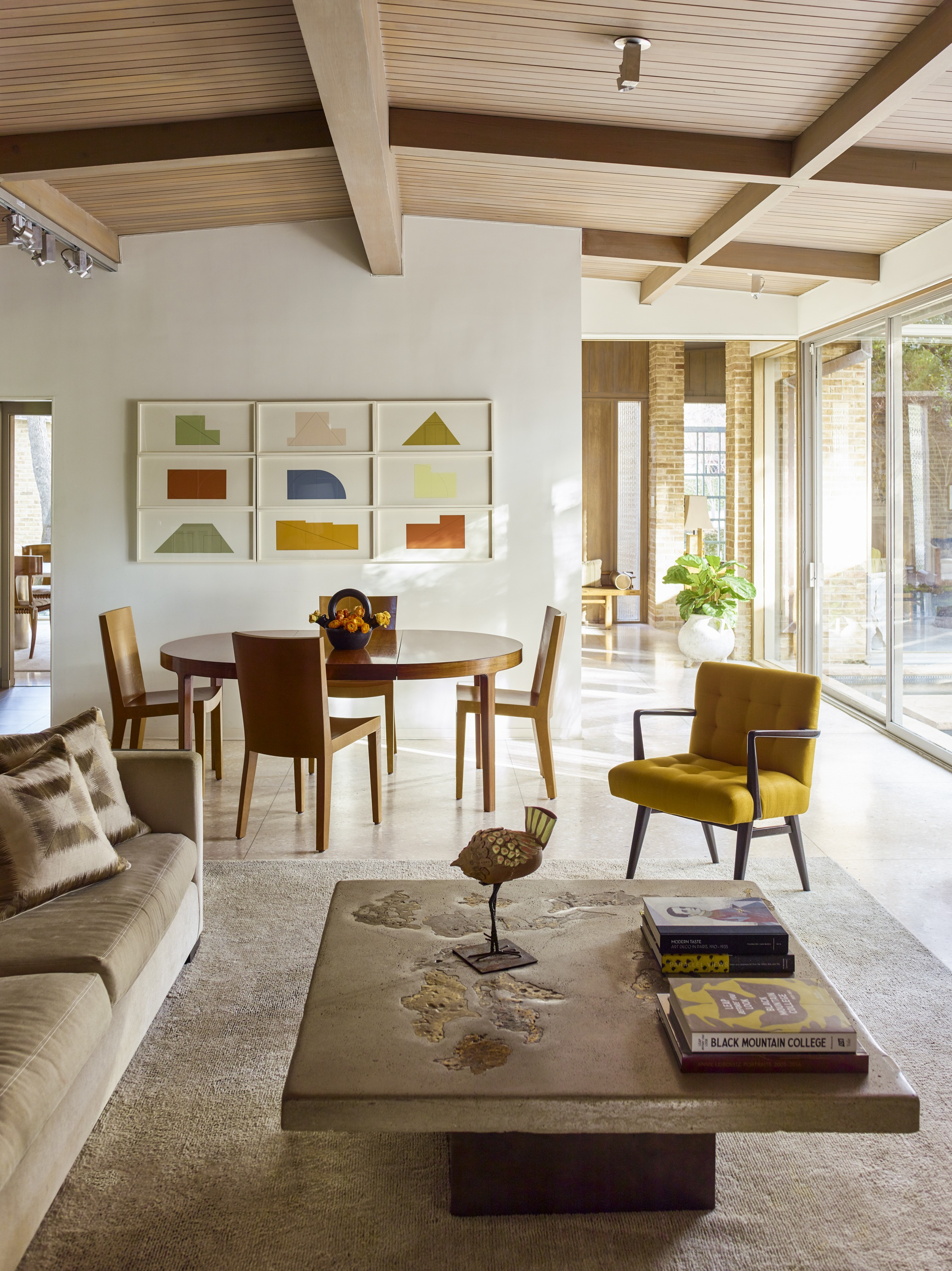 The family room features a Silas Seandel's concrete, steel, and bronze coffee table. The artworks are by Robert Mangold.
