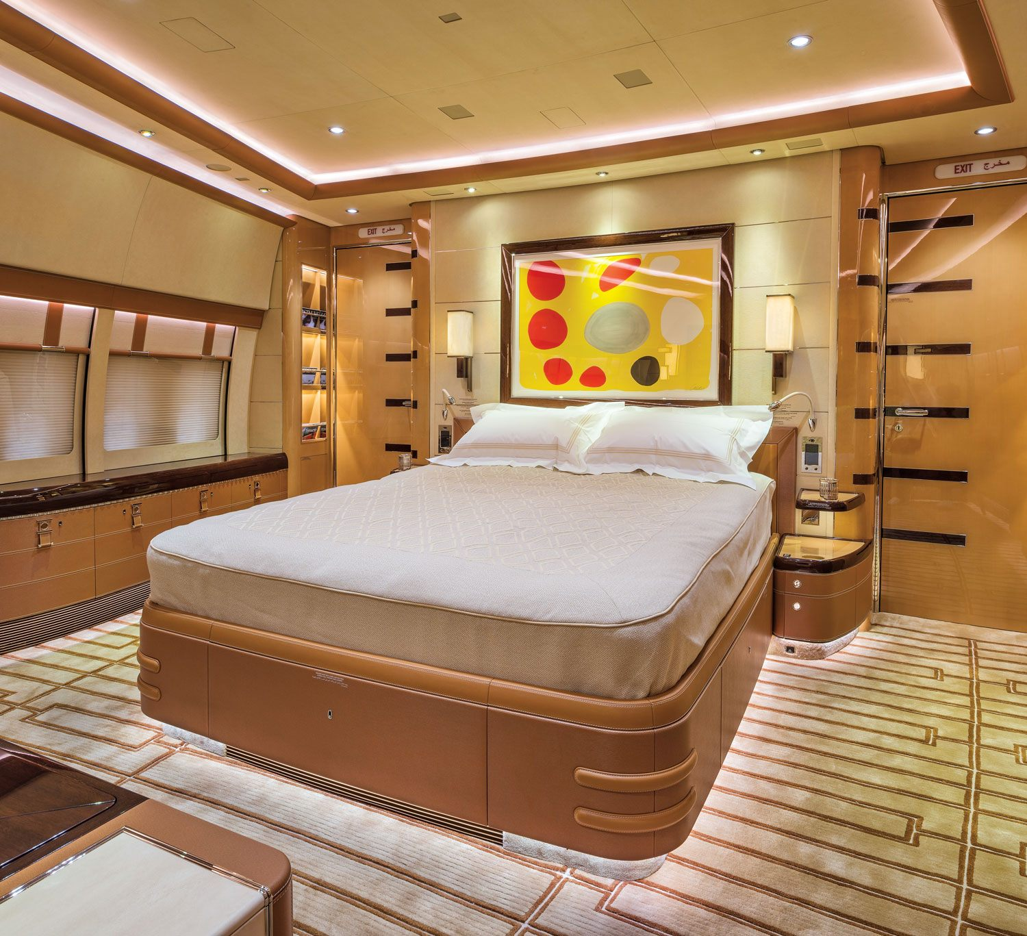 In the master bedroom of the private Boeing 747-8, an etching by Alexander Calder hangs above an Alberto Pinto-designed embossed leather bed with a saddle-stitch detail.