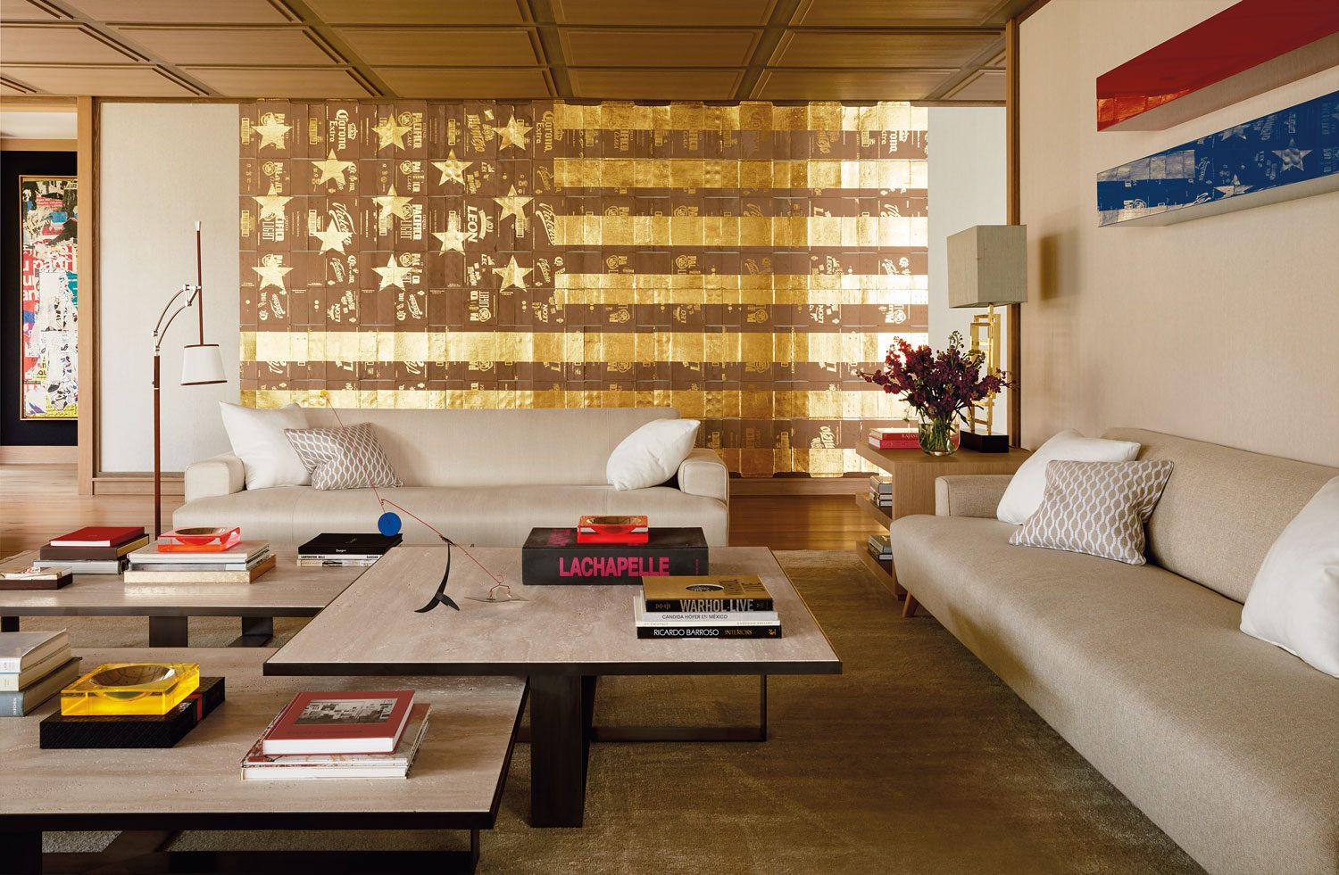 An overscale Danh Vo American flag painting and a two-part wall piece by John McCracken feature in the living area of collector Eugenio López's home. The tabletop sculpture is by Alexander Calder.