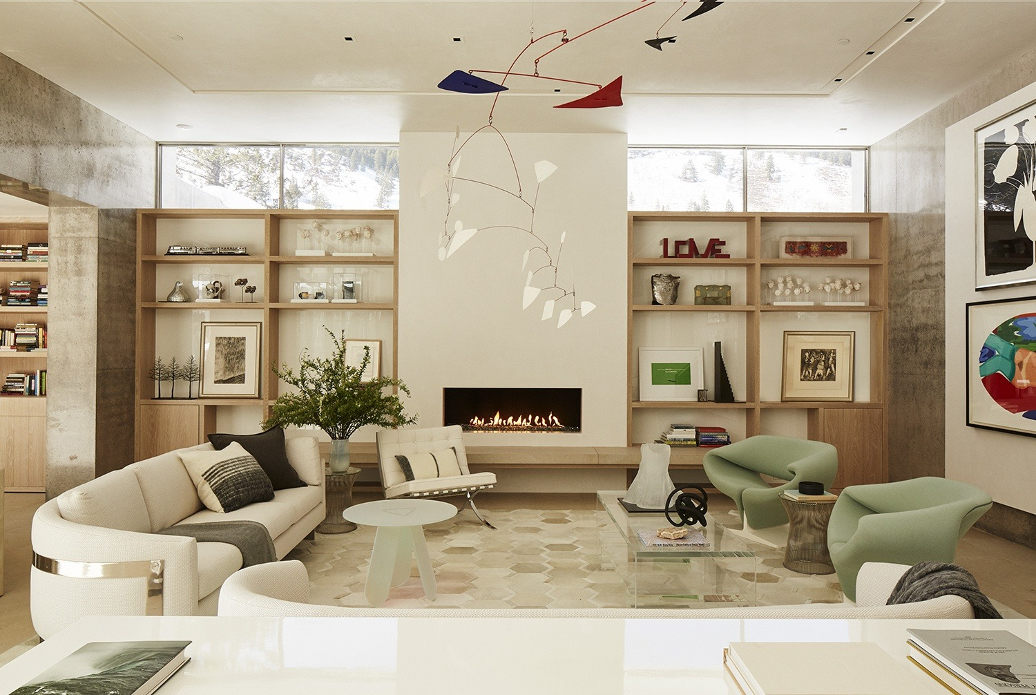 The living room in this Michael Imber-designed home was produced around a massive Alexander Calder mobile, while a floating wall was installed to display works by Donald Sultan and Tom Wesselmann from the homeowner's collection.
