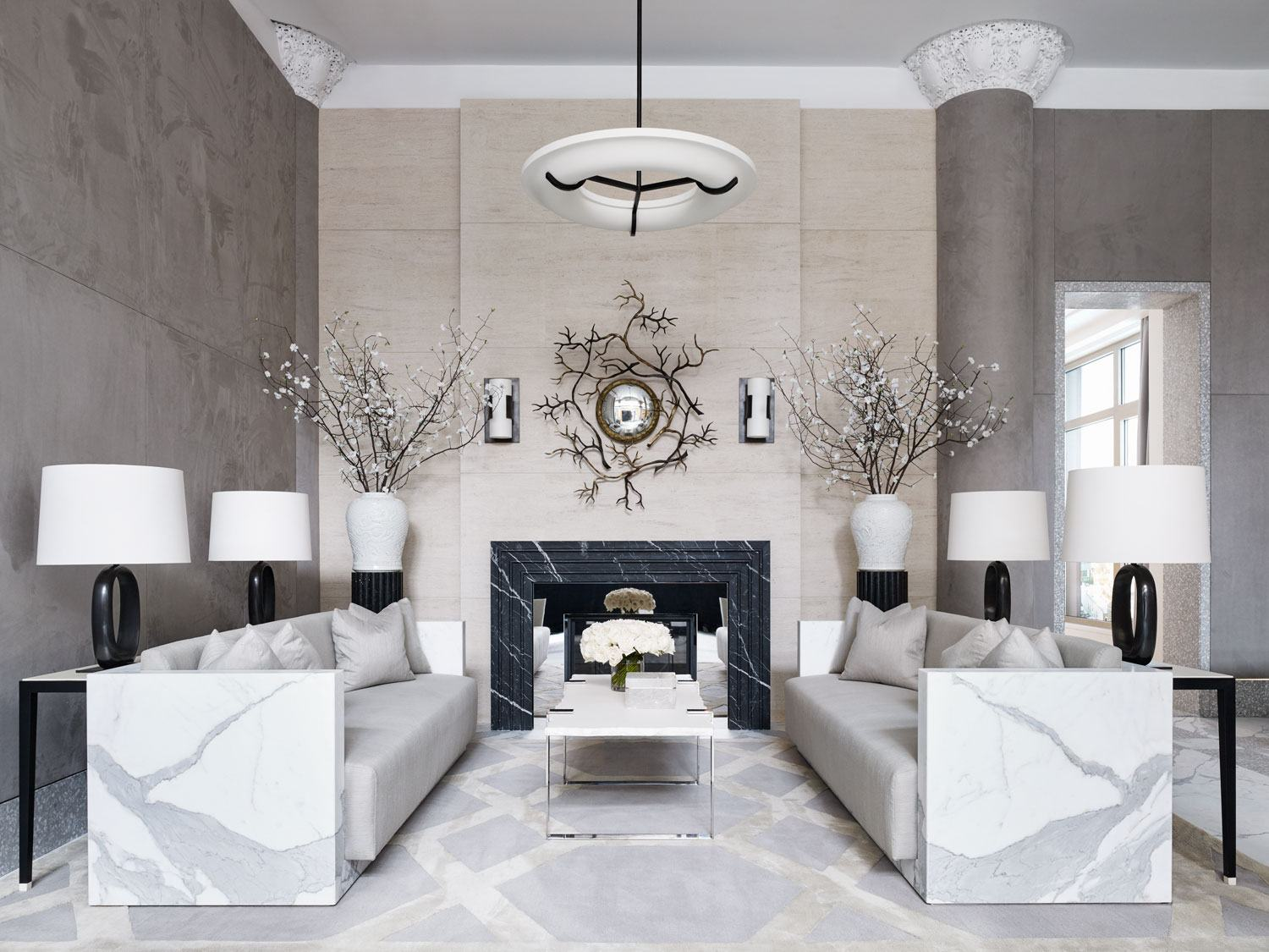 This living room designed by Ryan Korban is filled to the brim with marble. The Statuary marble sofas beautifully contrast hard and soft elements.