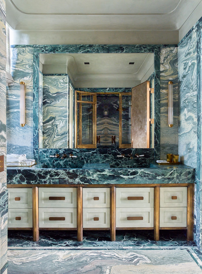 Emerald-green Verde Saint Denis marble and light-green Verde Luana and Cipollino Verde marbles are used as vibrant pops of color in this bathroom designed by Steven Gambrel.