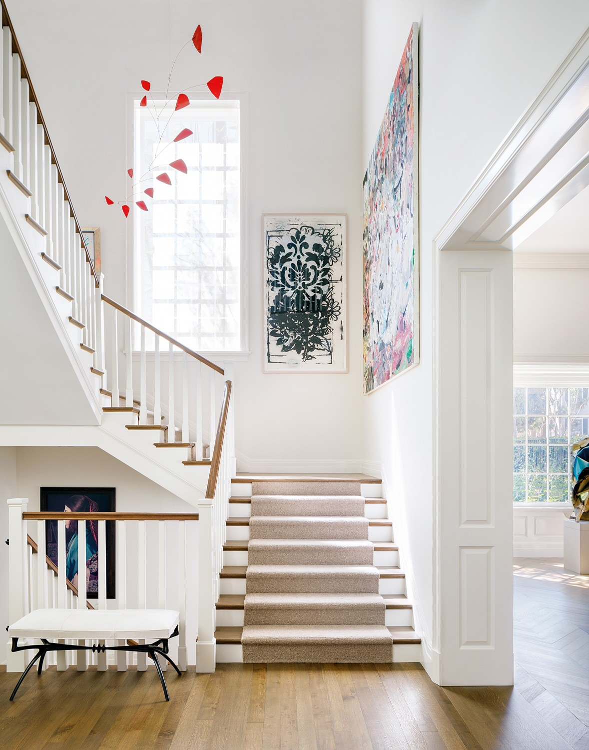 A Calder mobile suspends over a staircase in a La Jolla home designed by Madeline Stuart.