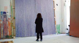 "Pat Steir beside her painting, ""Lila Judith"""