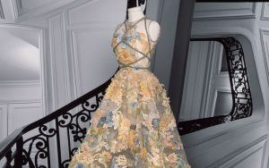 Dior's Maria Elena Look: Bustier dress in turtledove gray tulle, with Chantilly lace appliqué composed of cerulean blue, saffron yellow, Falun red and jasper.
