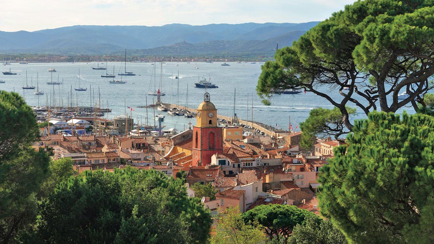 View of the city of St. Tropez from the Citadel featuring the iconic bell tower of the Church of St. Tropez.
